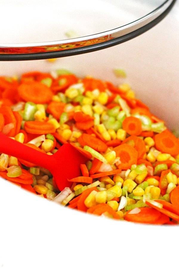 Carrots, celery and onion mixed together in crockpot