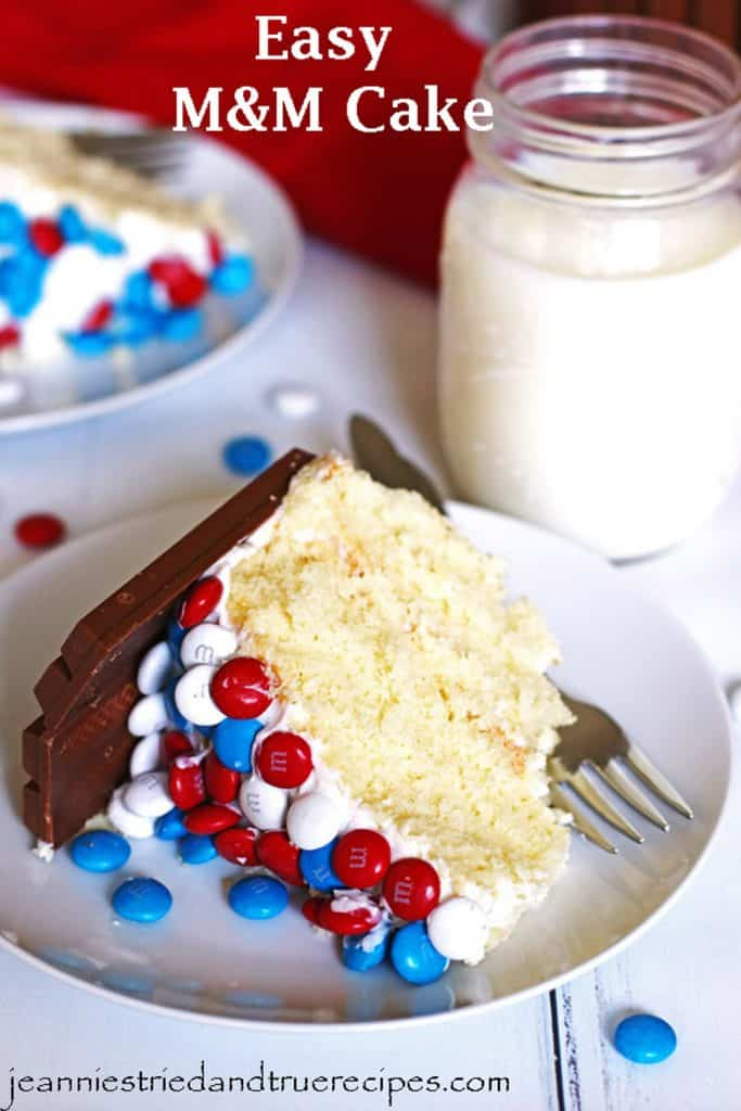 Sliced M&M Cake on white dessert plates with a clear glass of milk and sliced cake next to them