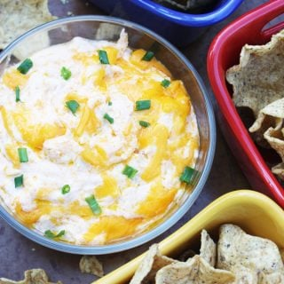 Buffalo Chicken Wing Dip in a bowl with tortilla chips in colorful bowls