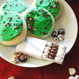 Elf Donuts on a white plate with cookies