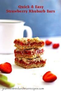 Strawberry Rhubarb Bars stacked next to a coffee mug