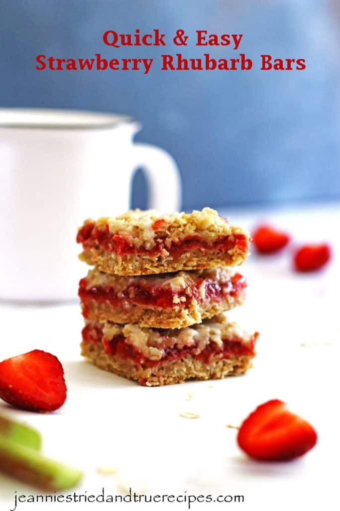 Strawberry Rhubarb Bars stacked next to a coffee mug