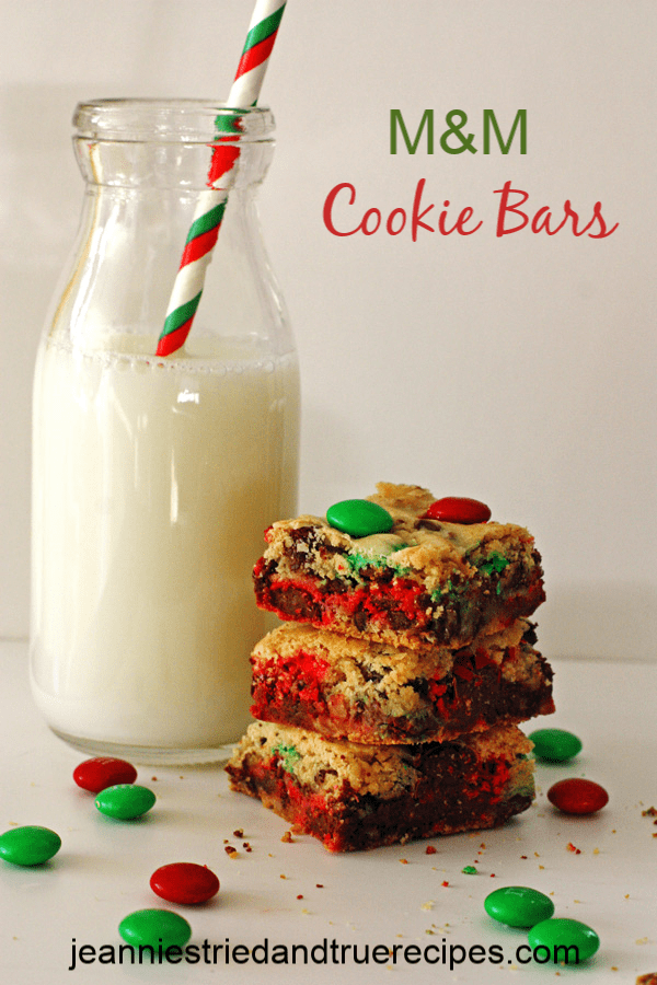 Festive M&M Cookie Bars are a delicious and easy recipe to make for the holidays or for any day of the year! #holidaybaking #christmascookies #dessert #easydessertrecipe #cookiebars