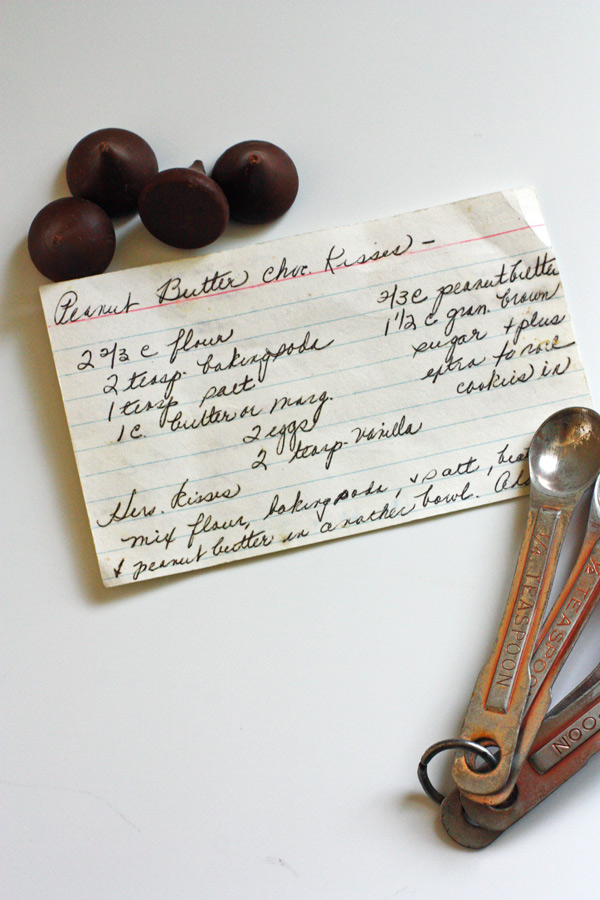 Recipe card hand written out sitting on white counter top