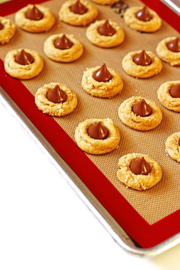 Peanut Butter Kiss Cookies lined up on cookie sheet