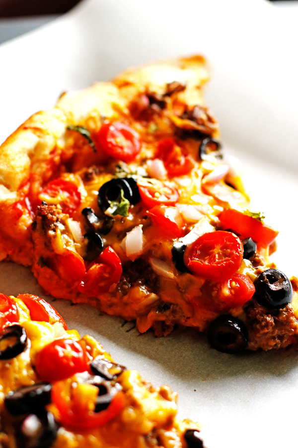 This Taco Pizza recipe puts two favorites together...tacos and pizza.