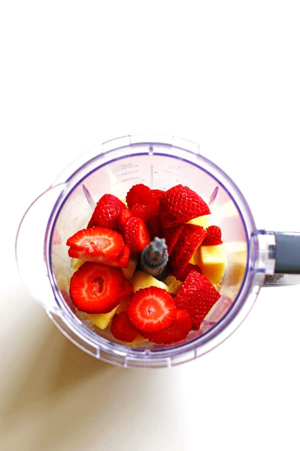 Pineapple, water and strawberries in blender