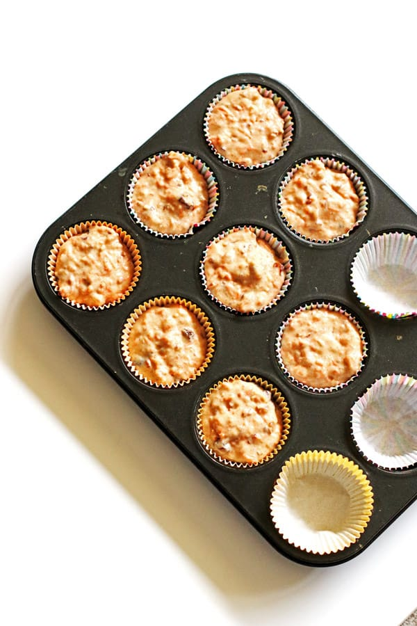 Carrot Cake Muffin batter in lined muffin tin cups