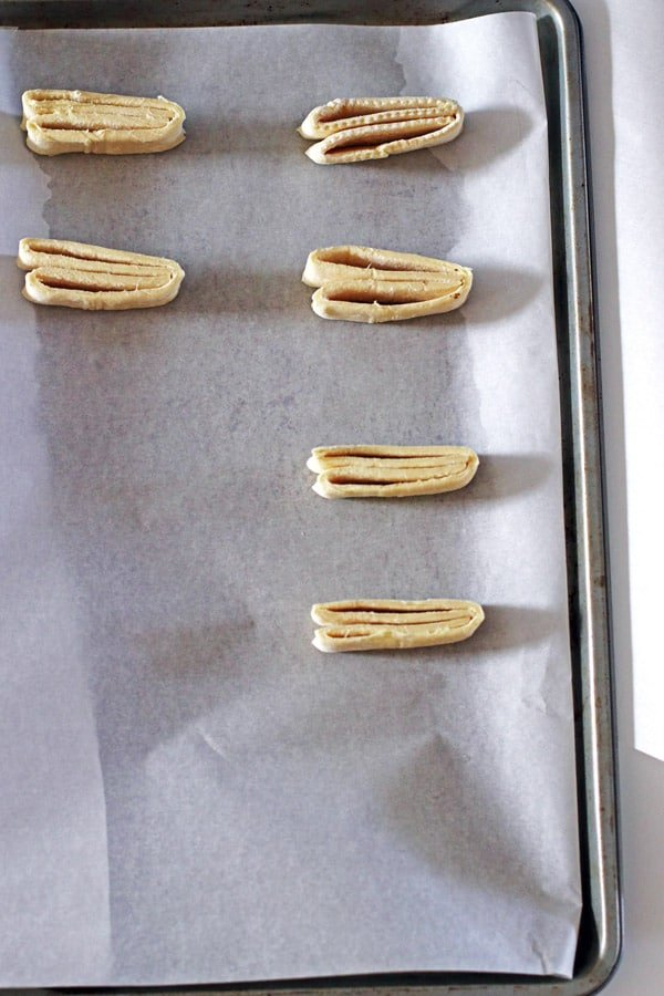 Sliced puff pastry on baking sheet