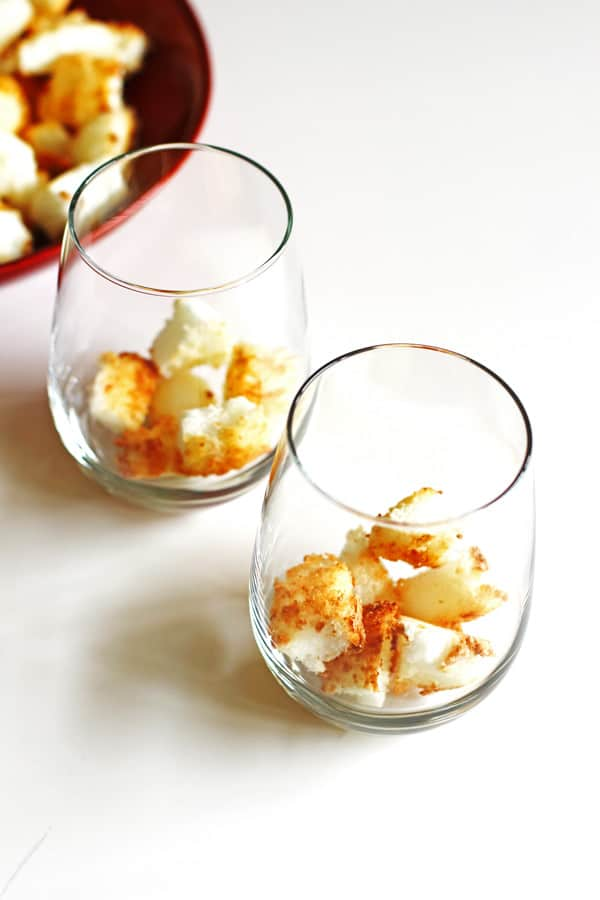 Cubed pieces of toasted angel food cake in clear glasses