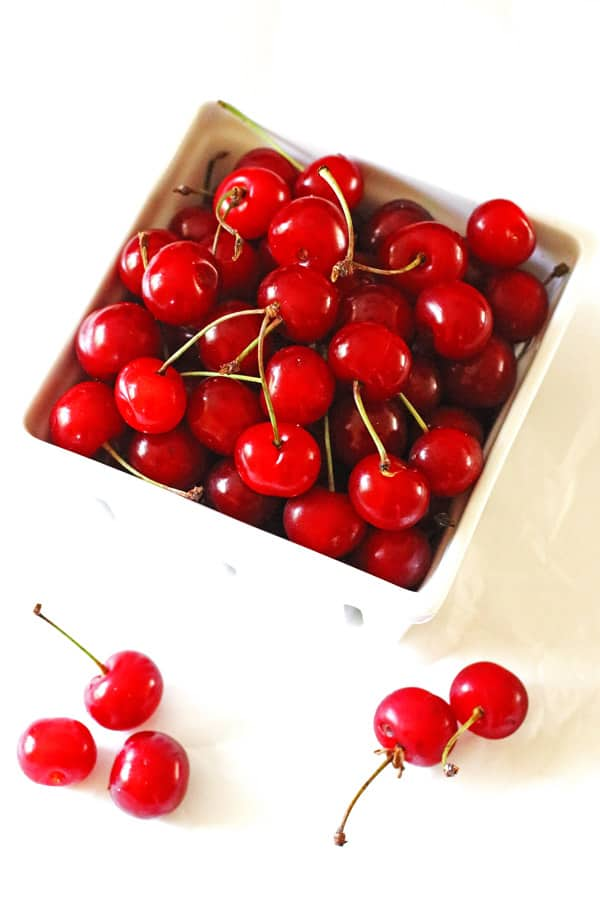 Tart cherries in a white quart basket