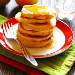 Apple Cinnamon Pancakes on a plate with syrup