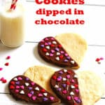 Sugar Cookies in the shape of hearts are dipped in chocolate and covered with heart shaped sprinkles.