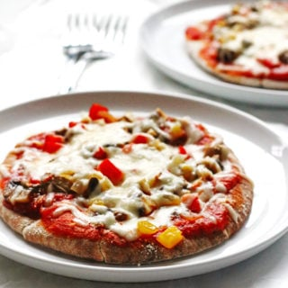 This recipe for Veggie-Pita-Pizza makes individual pizzas. They are made with whole wheat pitas and covered with peppers, onions, mushrooms and cheese.