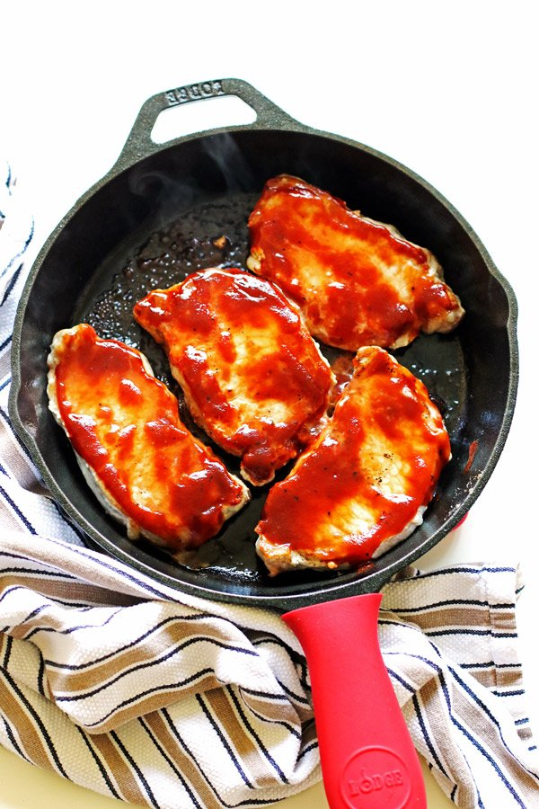 These Barbecue Pork Chops are easy to make in your cast iron skillet.