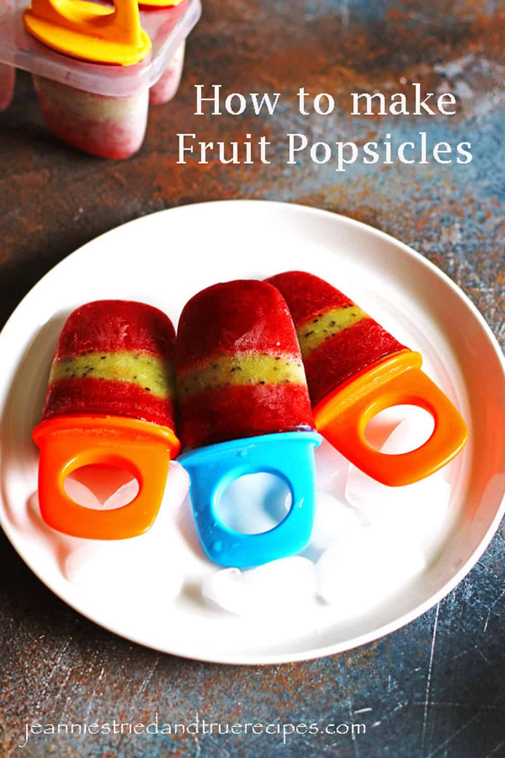 Fruit Popsicles on a white plate with ice cubes