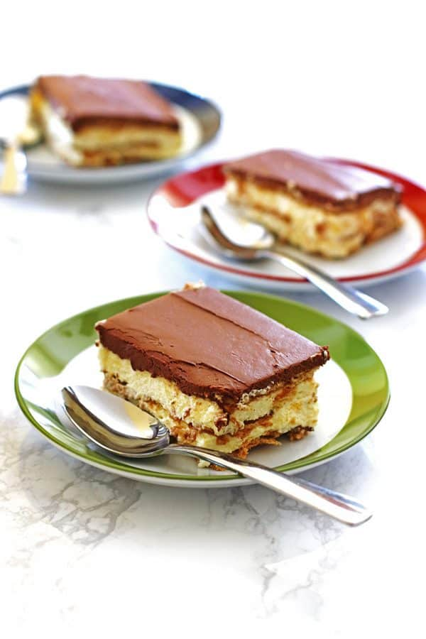 Slices of Eclair Cake on green, red and blue plates