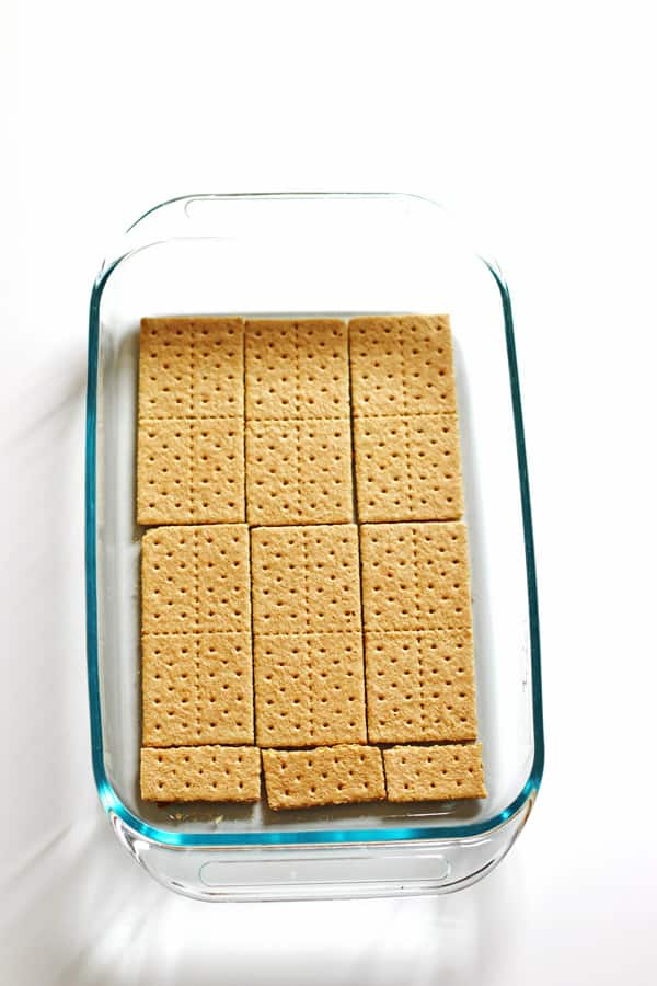 Graham crackers placed at the bottom of a 13 x 9 baking dish
