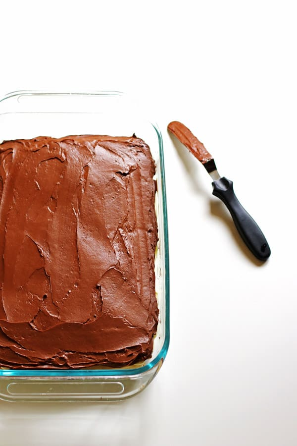 Eclair Cake covered with chocolate frosting in 13 x 9 baking dish