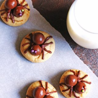 Peanut Butter Spider Cookies with milk in a glass