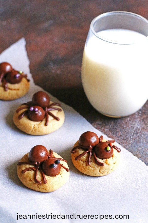 Peanut Butter Spider Cookies with a glass of milk