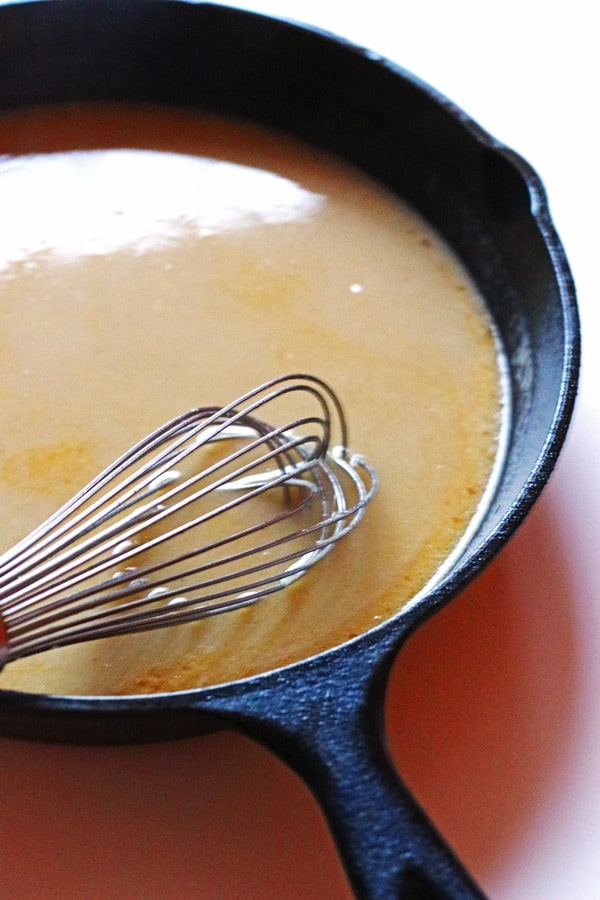 Whisking the gravy for the turkey