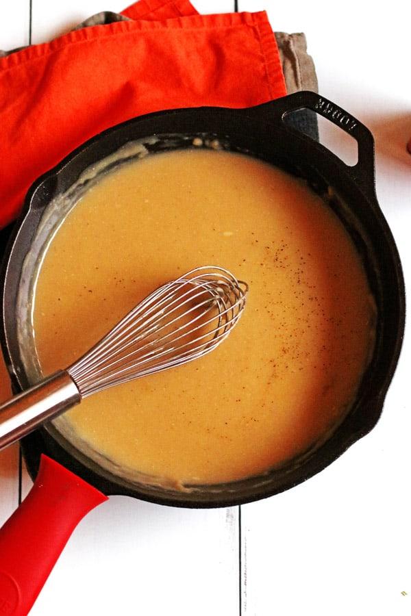 Whisking turkey gravy in a skillet
