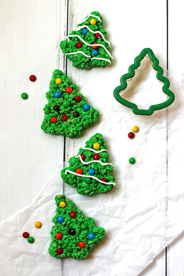 Green Rice Krispie trees decorated with M&M candy and white icing