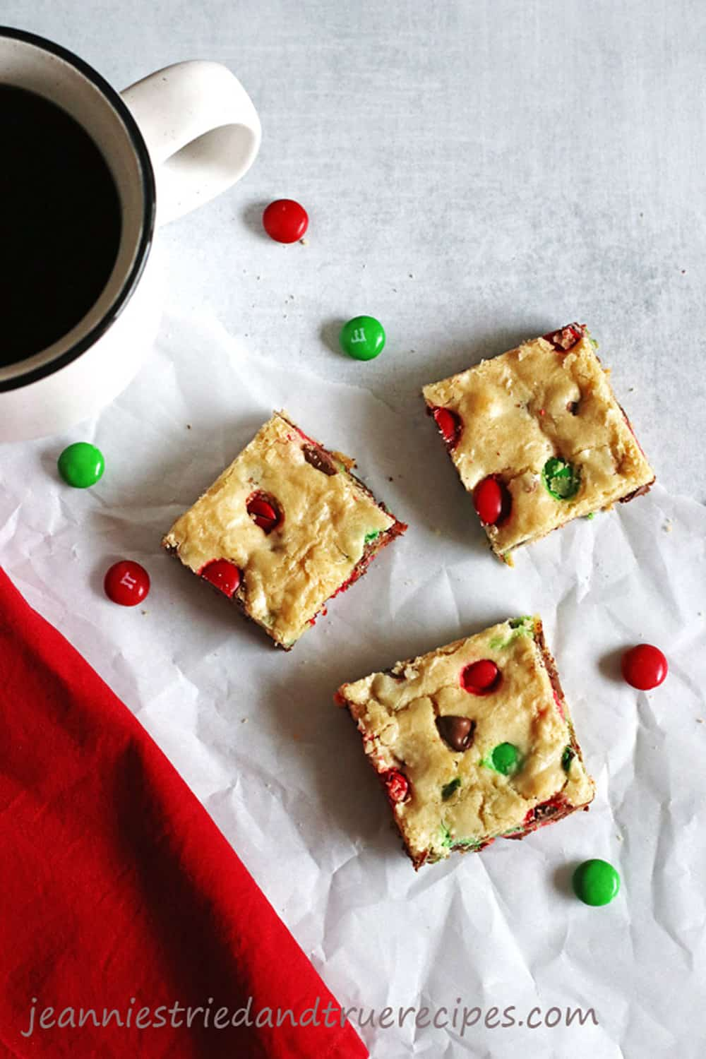 Cookie Bars cut into squares with a cup of coffee