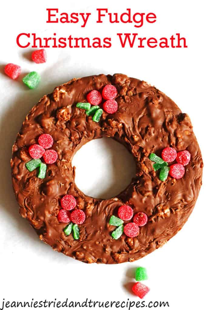 Fudge shaped as a Christmas wreath with gumdrops as berries on top of it.