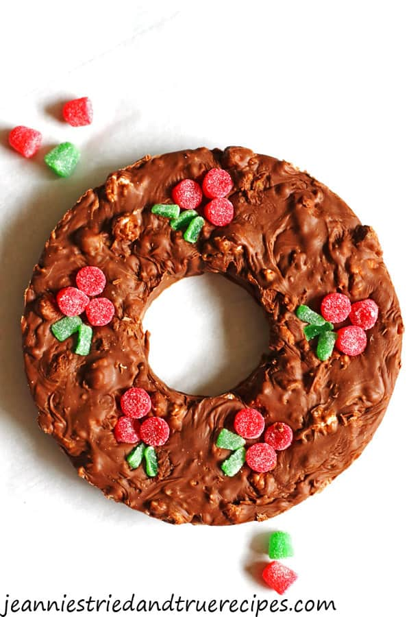 Fudge that is shaped into a Christmas wreath with gumdrops as the berries