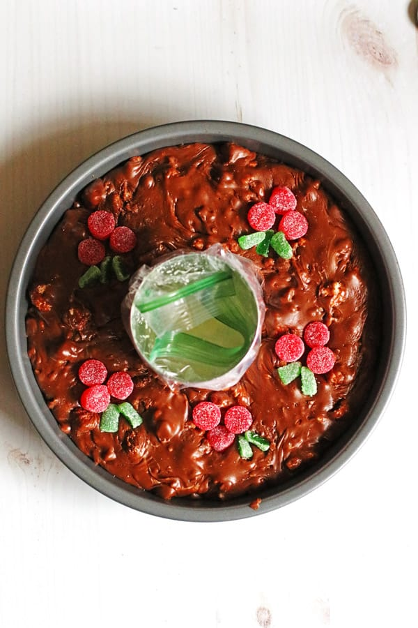 Fudge placed in a round cake pan with the can from the condensed milk in the middle.