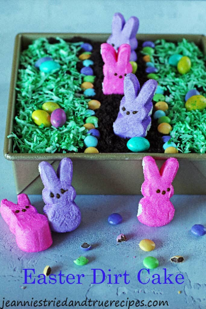 Dirt Cake with green colored shredded coconut for grass and bunny Peeps and egg candy on top.