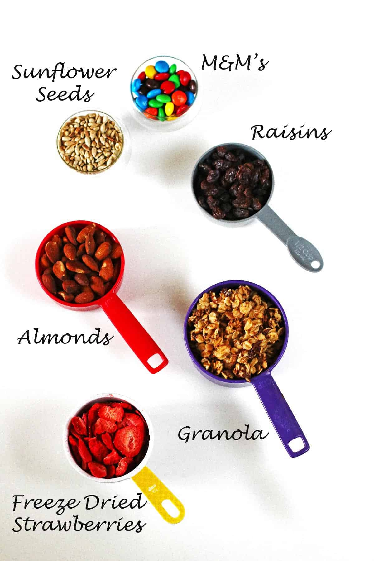 Ingredients in measuring cups for the trail mix